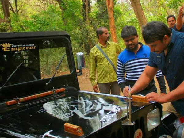 Challenging star darshan autograph on fan jeep