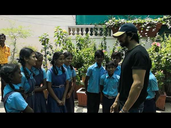 Kichcha Sudeep Charitable Society provided shoes and socks to school students