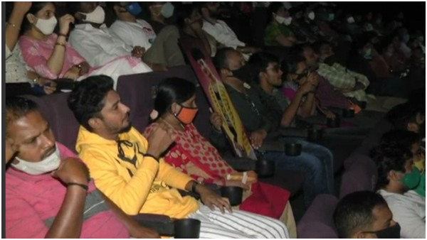 Parents watched Puneeth Rajkumars Yuvaratna movie with demised son photo in Theatre
