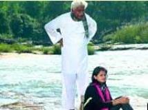 https://kannada.filmibeat.com/img/2009/12/16-rasarushi-kuvempu1.jpg