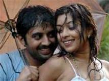 https://kannada.filmibeat.com/img/2010/03/01-varshadhare1.jpg