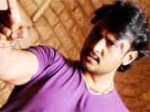 https://kannada.filmibeat.com/img/2010/05/22-darshan1.jpg