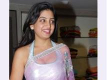 http://kannada.filmibeat.com/img/2011/07/11-poonam-kaur44.jpg