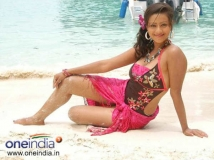 https://kannada.filmibeat.com/img/2012/12/13-madalasa-sharma1.jpg